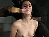 Skinny and pale tied up chick stands on knees while black dude mouthfucks her
