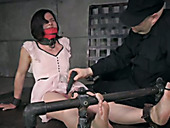 Old perve stimulates clit of tied up chick