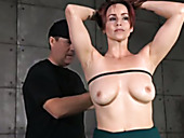Red haired pretty submissive chick gets her hands clasped behind