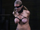 Buxom slut is riding Sybian machine in the dungeon while being blindfolded