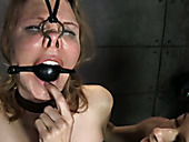Master punishes chick with clothed pins and metal hook