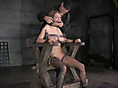 Filthy blonde is shackled to a wooden chair and electrocuted