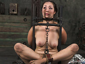 Flexible girl is tied up and chained in tricky position in BDSM clip