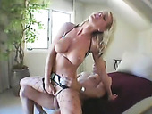 Buxom blonde hooker in fishnet stockings riding big dick on top