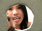 Sizzling Filipina girl sucking big cock through the gloryhole