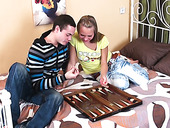 Appetizing teen gives her head after playing backgammon