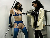 Crucified brunette in blue stuff gets boobies pumped and pussy tickled