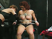 Submissive mature nympho is tied up and gets tits pinned with pegs