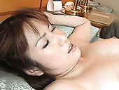 Hot Asian chick loves having her pussy played with and she loves to suck balls