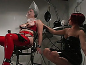 Brave fetish slut in latex stockings enjoying hardcore BDSM session