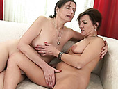 Mature lesbians pussy licking and fingering each other