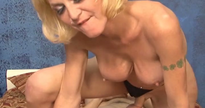 Mature blonde shemale riding solid pecker in a cowgirl pose