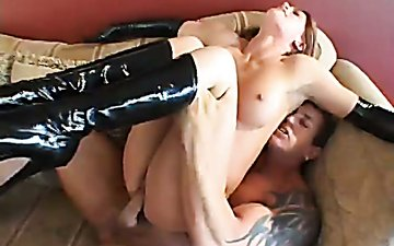 Seductive whore wearing high knee boots and latex gloves rides hard cock