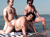 Two perverted dudes fuck ugly plumper on the yacht