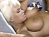 Short haired extremely busty blondie gets her pussy nailed from behind