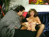 Auburn curly MILF in black lingerie masturbates and gets analfucked hard