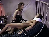 Messy haired brunette vintage domme rides chained dude's cock on bed