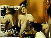 Two busty vintage nymphos show off their skills in giving nice titjob