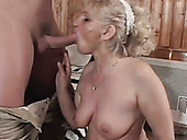 Nasty blonde granny in red stockings fucked bad missionary style