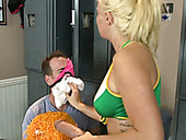 Hot cheerleader fucks a nerdy guy with a strap-on dildo in the locker room