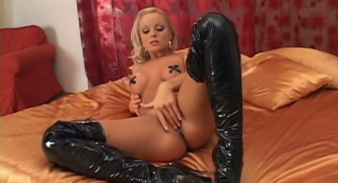 Blonde milf Silvia Saint in sexy latex skirt and black boots