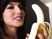 Incredibly hot Sunny Leone erotically eats banana in the kitchen