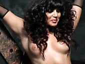 Beautiful babe Sunny Leone is tied up in torture room
