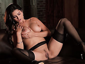 Babe in black stockings Sunny Leone licks her boobies and tickles slit
