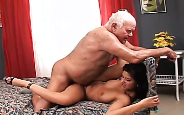 Stunning girl with big boobs rides a grandpa's dick