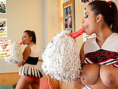 Mega busty cheerleader plays with boobs and pussy in front of a mirror