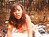 Asian chubby redhead whore rides a dick in the garden