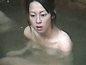 Some Asian chicks take hot soap public bath and flash their titties