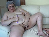 Fat disgusting mature hooker and fresh black haired cutie masturbate on sofa