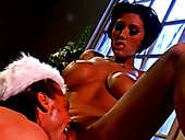 Tanned babe Dylan Ryder gives good blowjob to horny Santa under xmas three