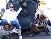 Duo of filthy sex dolls piss near roadside trash box