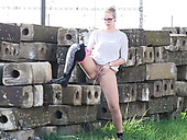 Curvy blond slut in glasses wants to be caught pissing outdoors