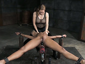 Titless ebony harlot is punished with sex machine and big black strapon