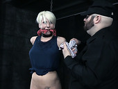 Bearded master masturbates pussy of belted and suspended blonde