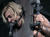 Restrained blonde with sexy tattoos on her body gets punished in the basement