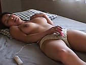 Busty Japanese chick masturbates with small but powerful vibrator