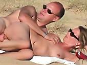 Amateur nudists fuck dirty on a beach in sideways position