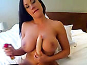 Killer beauty with juicy jugs pokes her twat with big dildo