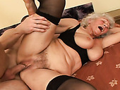 BBW granny in stockings riding young stud in a cowgirl position