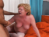 Kinky granny in stockings fucked bad in a doggy position