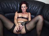 Pale long legged brunette nympho in nylon stockings fingers her twat