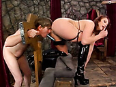 Crucified dude licks anal hole of one horny red haired mistress