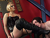 Short haired blonde MILFie domme in latex corset makes dude give rimjob