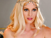 Graceful blonde Charlotte Stokely enjoys playing with her slit