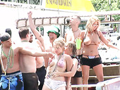 Naughty nude chicks go wild at the beach party