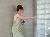 Nice red haired chick Crystal Clark is masturbating her muff in the shower in front of the mirror